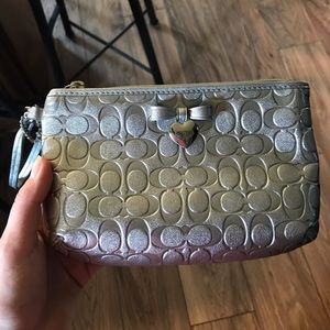 Silver/metallic Coach clutch/wristlet